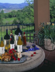 Napa winemaker and bottles of wine on table